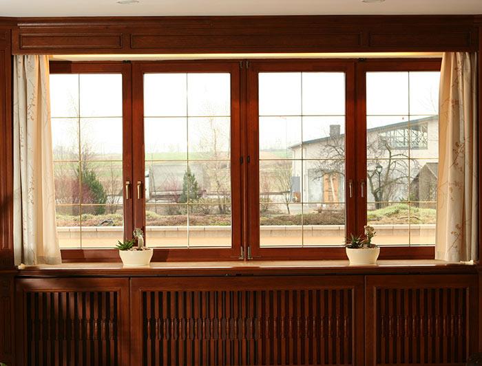Благодаря ламинации пластиковые окна можно подобрать под интерьер